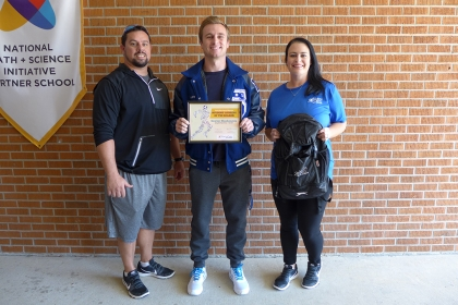 Sawyer Blankenship with Springfield High School Head Football Coach Ryan Serpas and North Oaks Sports Medicine Athletic Trainer Mandy Serpas